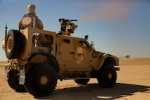 U.S. Marines with 2nd Low Altitude Air Defense Battalion Counter-Unmanned Aerial Systems Detachment, attached to Special Purpose Marine Air-Ground Task Force Crisis Response-Central Command, fire the Marine Air Defense Integrated System Mine Resistant Ambush Protected Vehicle during a live-fire range in southwest Asia Feb. 18, 2019. The MADIS is the first vehicle to utilize kinetic and non-kinetic measures to disable Counter-Unmanned Aerial Systems. SPMAGTF-CR-CC is specifically designed to be capable of deploying aviation, ground, and logistics forces forward at a moment's notice.