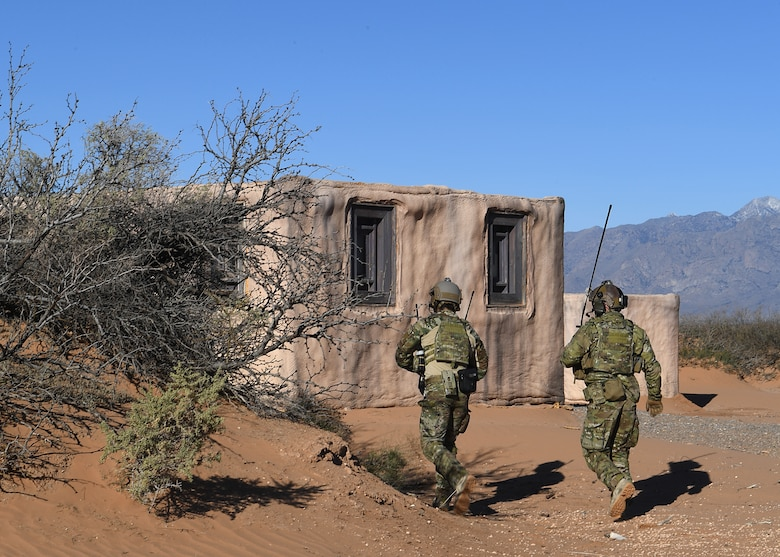 U.S. Air Force combat rescue officer students from the 351st Special Warfare Training Squadron train with tactical air control party members, assigned to the 7th Air Support Operations Squadron, on calling in close air support and nine lines on Red Rio Range, N.M., March 14, 2019. The CROs and TACPs worked with MQ-9 Reapers from Holloman Air Force Base, N.M., to simulate real world scenarios and improve communication with the pilots. (U.S. Air Force photo by  Senior Airman Haley Phillips)
