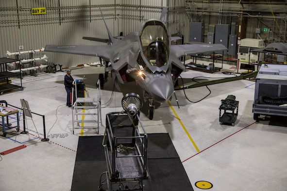 A U.S. Marine Corps F-35B from Air Test and Evaluation Squadron 23 (VX-23), Naval Air Station Patuxent River, Maryland, undergoes a ground test of an improved probe light assembly in an Edwards Air Force Base hangar Feb. 28. The F-35 program recently completed testing on an improved lighting assembly with the KC-135 Stratotanker that will enable the Navy and Marine Corps F-35 variants to refuel behind the tanker at night. Flight testing of the redesigned light, which attaches to a refueling probe, was led by Patuxent River Naval Air Station, Maryland, and supported by Edwards Air Force Base, California. (Courtesy photo by Jonathan Case/Lockheed Martin)