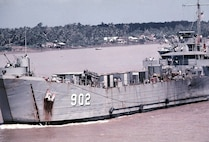 The USS Luzerne County (LST-902) in its heyday during the Vietnam War. The bell from the ship now resides aboard MCLB Barstow. (Official U.S. Navy photo)