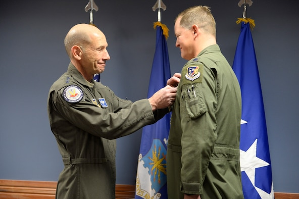 "U.S. Air Force Gen. Mike Holmes, commander of Air Combat Command, presents the Distinguished Flying Cross to Lt. Col. Timothy ""TJ"" Eaton"