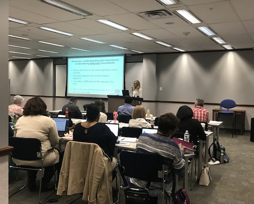 Lindsay Warner, a paralegal specialist with the Transatlantic Middle East District, gives a presentation on identifying relevant documents in legal discovery at the USACE worldwide paraprofessionals training.