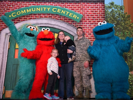 "A Grand Forks Air Force Base family poses for a photo beside cast members during a meet and greet with the ""Sesame Street Live"" cast on March 26, 2019, on Grand Forks Air Force Base, North Dakota. The meet and greet allowed families in attendance the chance to meet the characters prior to a performance of dance and song, which emphasized the importance of kindness in a community. (U.S. Air Force photo by Airman 1st Class Melody Wolff)"