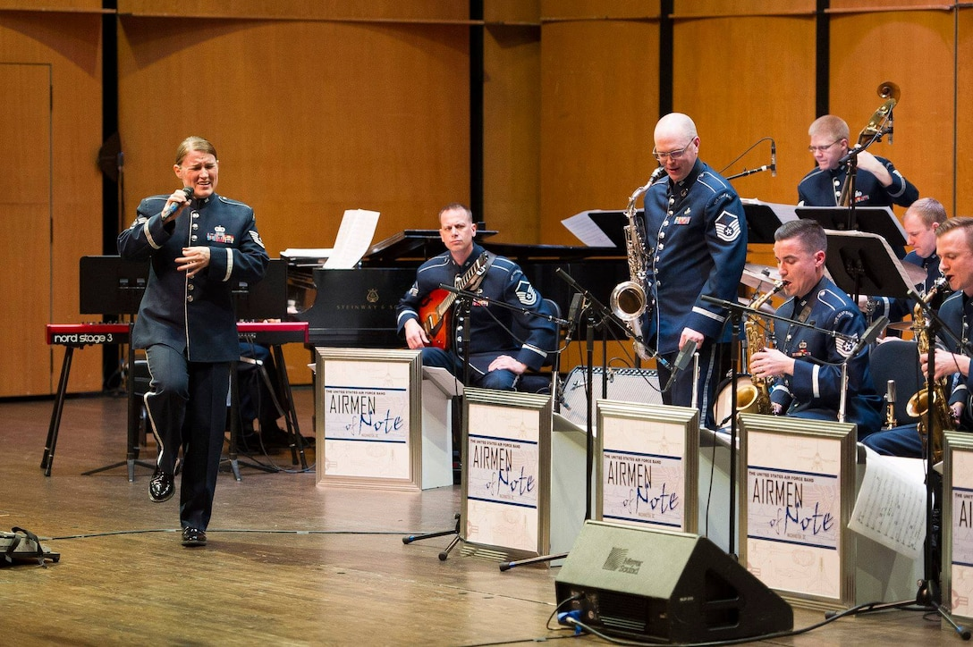 Tech. Sgt. Paige Wroble, Airmen of Note vocalist, left, sings during a Jazz Heritage Series concert at the Rachel M. Schlesinger Concert Hall and Arts Center on the Northern Virginia Community College campus in Alexandria, Va., March 22, 2019. (U.S. Air Force photo by Master Sgt. Michael B. Keller)
