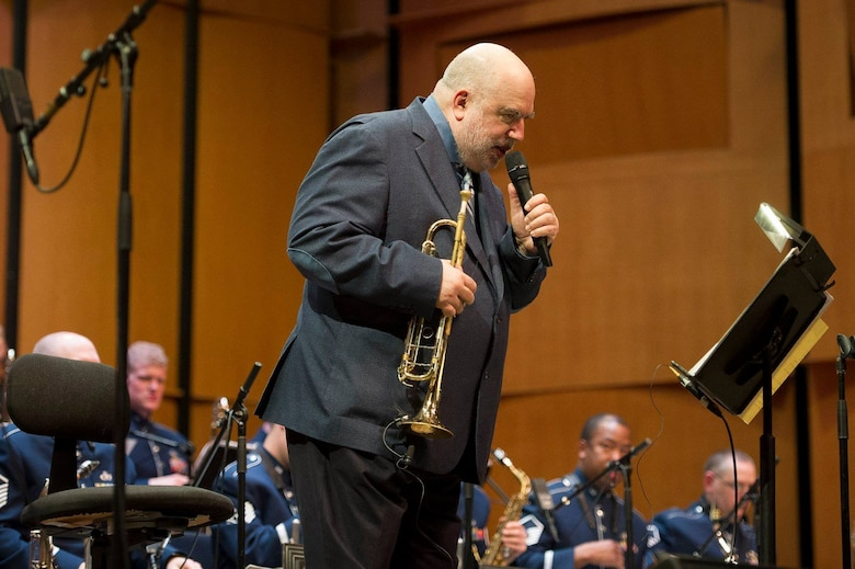 Jazz trumpeter and composer Randy Brecker gives the back story of one of his hits during a Jazz Heritage Series concert at the Rachel M. Schlesinger Concert Hall and Arts Center on the Northern Virginia Community College campus in Alexandria, Va., March 22, 2019. (U.S. Air Force photo by Master Sgt. Michael B. Keller)