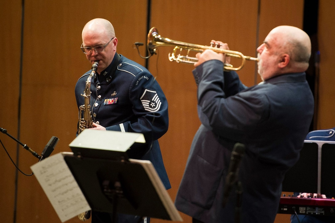 Master Sgt. Tedd Baker, Airmen of Note tenor saxophonist, left, performs with guest trumpeter Randy Brecker at the Rachel M. Schlesinger Concert Hall and Arts Center on the Northern Virginia Community College campus in Alexandria, Va., March 22, 2019. (U.S. Air Force photo by Master Sgt. Michael B. Keller)