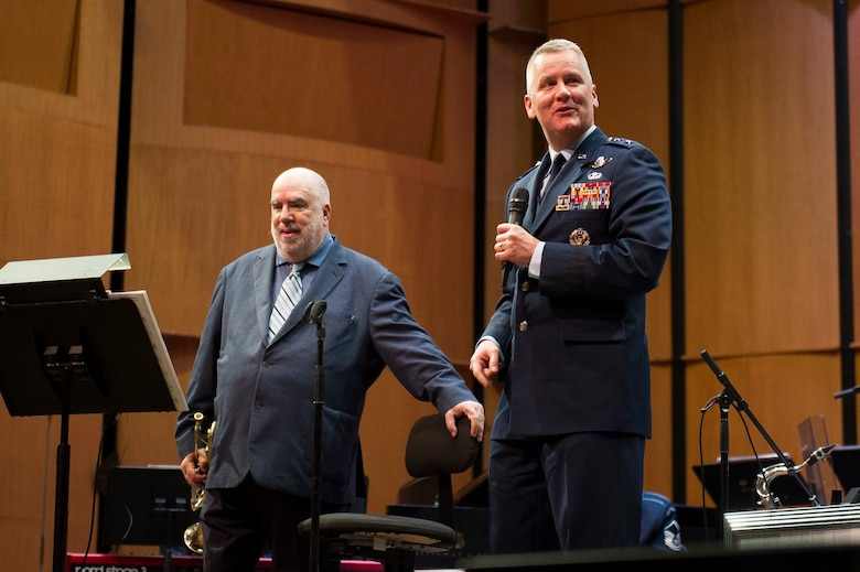 Maj. Gen. James A. Jacobson, Air Force District of Washington commander, right, thanks trumpeter and composer Randy Brecker after a Jazz Heritage Series concert with the U.S. Air Force Band's premier jazz ensemble, Airmen of Note, at the Rachel M. Schlesinger Concert Hall and Arts Center on the Northern Virginia Community College campus in Alexandria, Va., March 22, 2019. (U.S. Air Force photo by Master Sgt. Michael B. Keller)