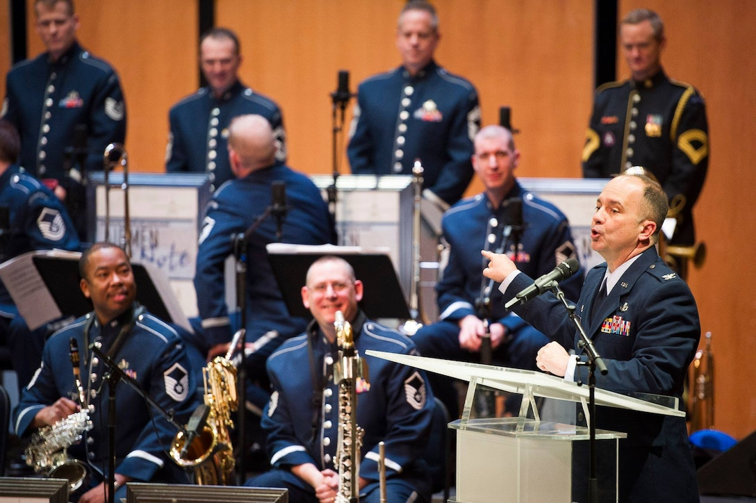 Col. Don Schofield, U.S. Air Force Band commander and conductor, introduces the Band's premier jazz ensemble, Airmen of Note, at the Rachel M. Schlesinger Concert Hall and Arts Center on the Northern Virginia Community College campus in Alexandria, Va., March 22, 2019. (U.S. Air Force photo by Master Sgt. Michael B. Keller)