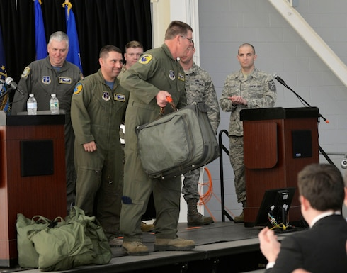Master Sgt. John Lennon, a boom operator assigned to the 157th Operations Group, grabs his flight bag to prepare for the final departure of the last KC-135 Stratotanker assigned to the 157th Air Refueling Wing at Pease Air National Guard Base on 24 March, 2019. With over 170,000 hours flown supporting every major conflict in recent history, the KC-135 has been an iconic part of Pease's legacy, and its departure marks the end of an era.(U.S. Air National Guard photo by Senior Airman Taylor Queen)