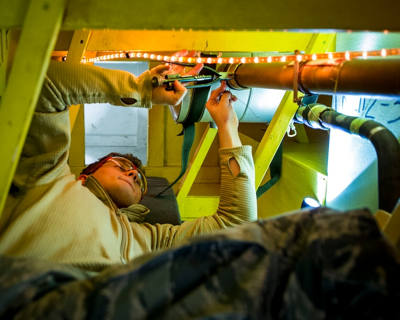 Members of the 133rd Aircraft Maintenance Squadron, Fuel Systems Maintenance shop, practice on maintenance and repairs tasks in a unique enclosed-space simulator that was created to mimic working in a real aircraft fuel tank in St. Paul, Minn., Feb. 23, 2019.