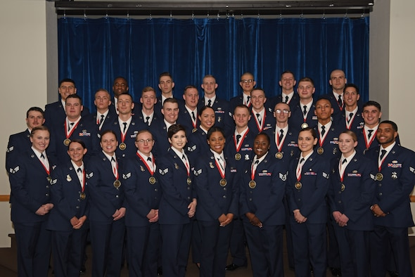 Col. Stacy Jo Huser, 90th Missile Wing commander, and Chief Master Sgt. Gemma Clark, 90th Missile Wing Interim command chief, pose with the graduating Airman Leadership School Class 19-D students in the Trail's End Event Center on F. E. Warren Air Force Base, Wyo., March 27, 2019. Enlisted Airmen must complete the rigorous professional military education course before supervising other Airmen. (U.S. Air Force photo by Senior Airman Nicole Reed)