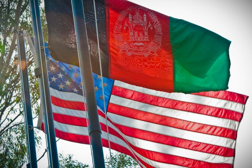 U.S. and Afghanistan flags fly on flagpoles