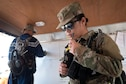 Capt. Maria Erc Guisadio-Abis, 154th Medical Group's Detachment 1 Operations Team chief, transmits mission-essential information zone during an evaluation exercise March 9, 2019, at Kalaeloa, Hawaii.