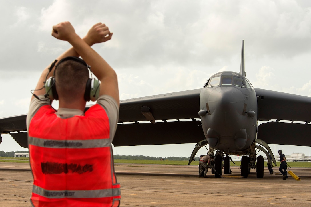 A U.S. Airman assigned to the 5th Maintenance Group marshals a B-52 Stratofortress during Diamond Shield 2019 (DS-19) at Royal Australian Air Force Base Darwin, Australia, March 26, 2019.