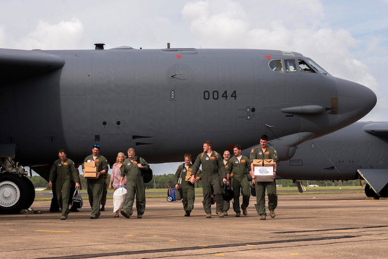 U.S. Airmen assigned to the 23rd Expeditionary Bomb Squadron help pilots and aircrew members unload a B-52 Stratofortress following a sortie in support of Diamond Shield 2019 (DS-19) at Royal Australian Air Force Base Darwin, Australia, March 26, 2019.