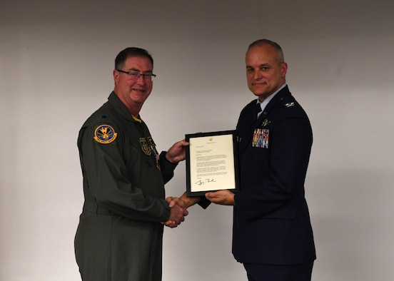 Lt. Col. Bryan Branby, chief of the 911th Airlift Wing Program Integration Office, receives his retirement certificate from Col. Jay D. Miller, vice commander of the 911th AW, at the Pittsburgh International Airport Air Reserve Station, Pennsylvania, March 22, 2019. Branby's family and friends joined him at his retirement ceremony to celebrate the long career he has had and support him on his next adventure. (U.S. Air Force photo by Senior Airman Grace Thomson)