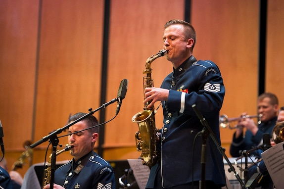 Tech. Sgts. Kristian Baarsvik, right, and Michael Cemprola, Airmen of Note alto saxophonists, perform during a Jazz Heritage Series concert at the Rachel M. Schlesinger Concert Hall and Arts Center on the Northern Virginia Community College campus in Alexandria, Va., March 22, 2019. The Airmen of Note are the U.S. Air Force Band's premier jazz ensemble. (U.S. Air Force photo by Master Sgt. Michael B. Keller)