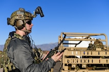 U.S. Air Force 2nd Lt. William, 351st Special Warfare Training Squadron combat rescue officer student, trains with tactical air control party members, assigned to the 7th Air Support Operations Squadron, on calling in close air support and nine lines on Red Rio Range, N.M., March 14, 2019. The CROs and TACPs worked with MQ-9 Reapers from Holloman Air Force Base, N.M., to simulate real world scenarios and improve communication with the pilots. Last names have been withheld due to operational security restraints.(U.S. Air Force photo by Senior Airman Haley D. Phillips)
