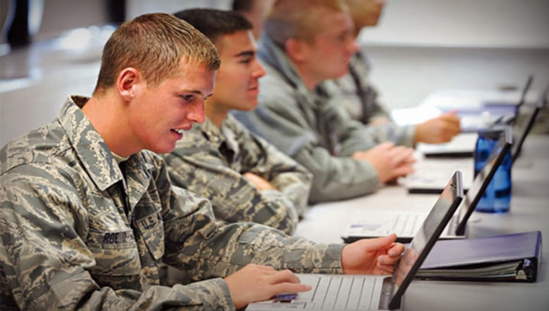 Airmen study using Air Force Network-powered laptops, made possible by the Program Executive Office for Command, Control, Communications, Intelligence and Networks at Hanscom Air Force Base, Mass. (U.S. Air Force stock photo)