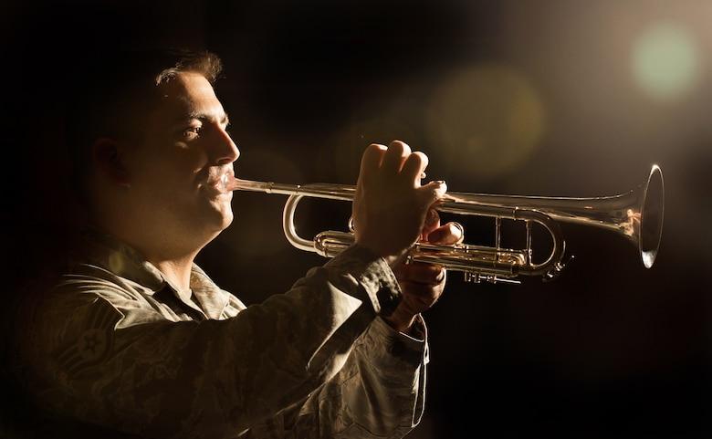 An Airman plays a trumpet