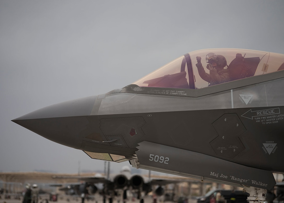 A pilot in a F-35A Lightning II fighter taxis down the ramp