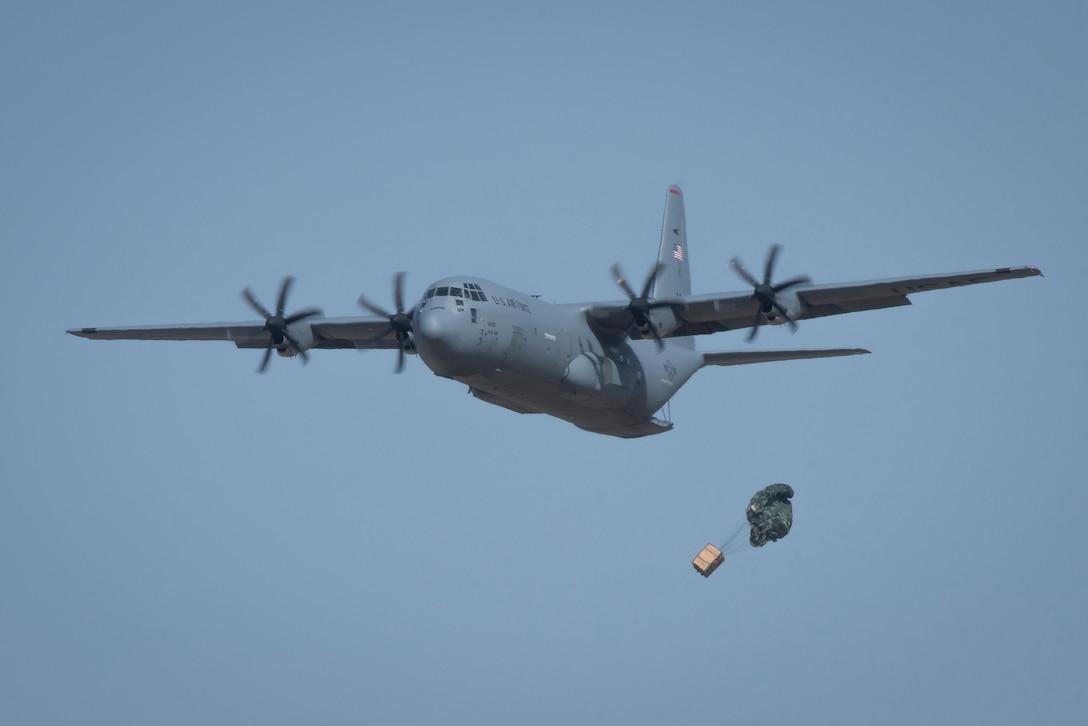 A C-130J Super Hercules performs an airdrop