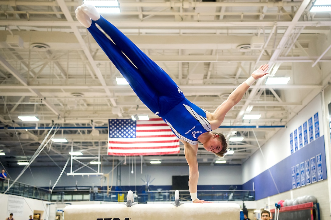 An Air Force Academy sophomore performs on the pommel horse
