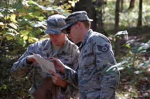Capt Kim, a True North Chaplain, leads Airmen in land navigation exercises.