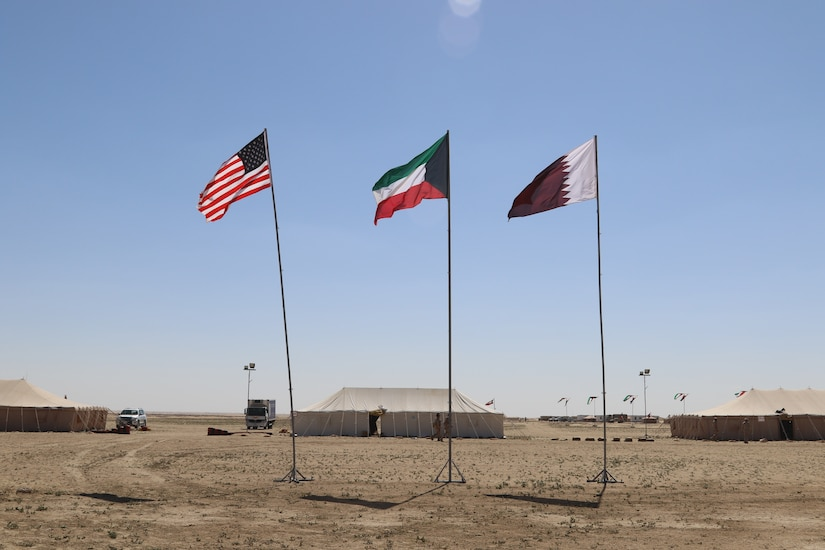 Flags of three partner nations, United States, Kuwait and Qatar, fly at Udairi Range in Kuwait, March 3, 2019. Soldiers of the Kuwait Land Forces, Qatari Emiri Forces, and U.S. Army gathered for Exercise Desert Leopard II on March 2-6, 2019. Desert Leopard began as a bilateral exercise between two nations within the Gulf Cooperation Council, Kuwait and Qatar. In December, 2018, leaders of the Kuwait Land Forces invited members of U.S. Central Command's Task Force Spartan to participate in the exercise, growing Desert Leopard II to include three nations.
