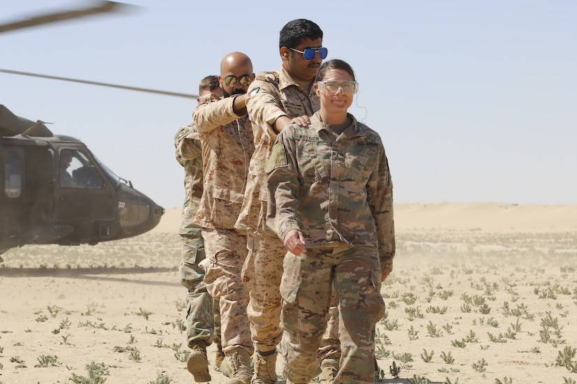 Medical personnel from the U.S. Army and Kuwait Land Forces complete their medical evacuation to a UH-60 Black Hawk helicopter belonging to the 2nd Battalion, 211th General Support Aviation Battalion, 35th Combat Aviation Brigade at Udairi Range in Kuwait, March 4, 2019. Soldiers of the Kuwait Land Forces, Qatari Emiri Forces, and U.S. Army gathered for Exercise Desert Leopard II on March 2-6, 2019. Desert Leopard began as a bilateral exercise between two nations within the Gulf Cooperation Council, Kuwait and Qatar. In December, 2018, leaders of the Kuwait Land Forces invited members of U.S. Central Command's Task Force Spartan to participate in the exercise, growing Desert Leopard II to include three nations.