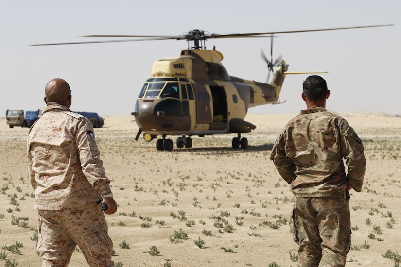 Medical officers from the Kuwait Land Forces and U.S. Army watch as a Kuwaiti AS332 Super Puma lands at their mock battalion aid station site at Udairi Range in Kuwait, March 5, 2019. Soldiers of the Kuwait Land Forces, Qatari Emiri Forces, and U.S. Army gathered for Exercise Desert Leopard II on March 2-6, 2019. Desert Leopard began as a bilateral exercise between two nations within the Gulf Cooperation Council, Kuwait and Qatar. In December, 2018, leaders of the Kuwait Land Forces invited members of U.S. Central Command's Task Force Spartan to participate in the exercise, growing Desert Leopard II to include three nations.