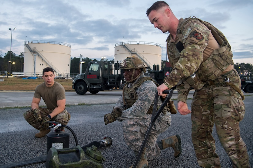 Col. Terrence Adams, 628th Air Base Wing commander, takes a knee at a checkpoint during a forward area refueling point team tryout March 26, 2019, at Joint Base Charleston, S.C.