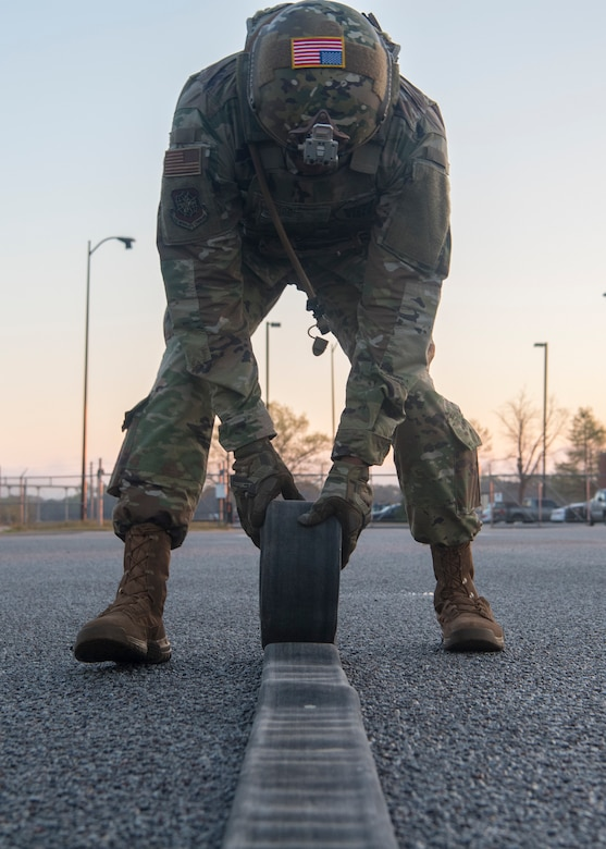 Chief Master Sgt. Todd Cole, 628th Air Base Wing command chief, rolls a refueling hose during a forward area refueling point team tryout March 26, 2019, at Joint Base Charleston, S.C.