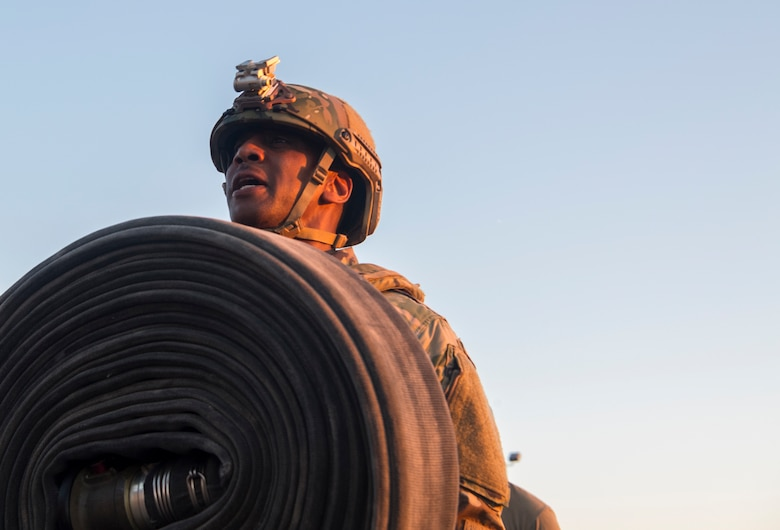 Chief Master Sgt. Todd Cole, 628th Air Base Wing command chief, carries a fuel hose during a forward area refueling point team tryout March 26, 2019, at Joint Base Charleston, S.C.