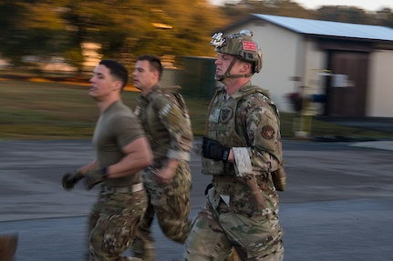 Airman 1st Class Aaron Griffith, 628th Logistics Readiness Squadron fuels distribution operator, runs to a checkpoint during a forward area refueling point team tryout March 26, 2019, at Joint Base Charleston, S.C.