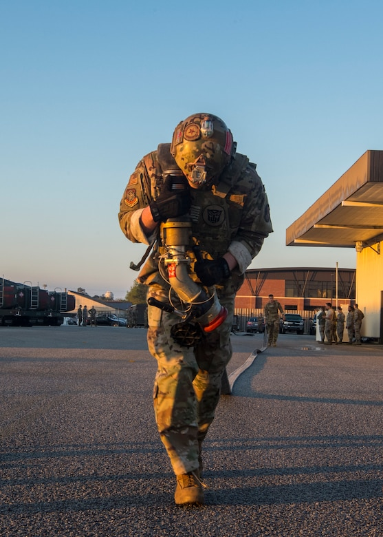 Airman 1st Class Aaron Griffith, 628th Logistics Readiness Squadron fuels distribution operator, carries a fuel hose during a forward area refueling point team tryout March 26, 2019, at Joint Base Charleston, S.C.