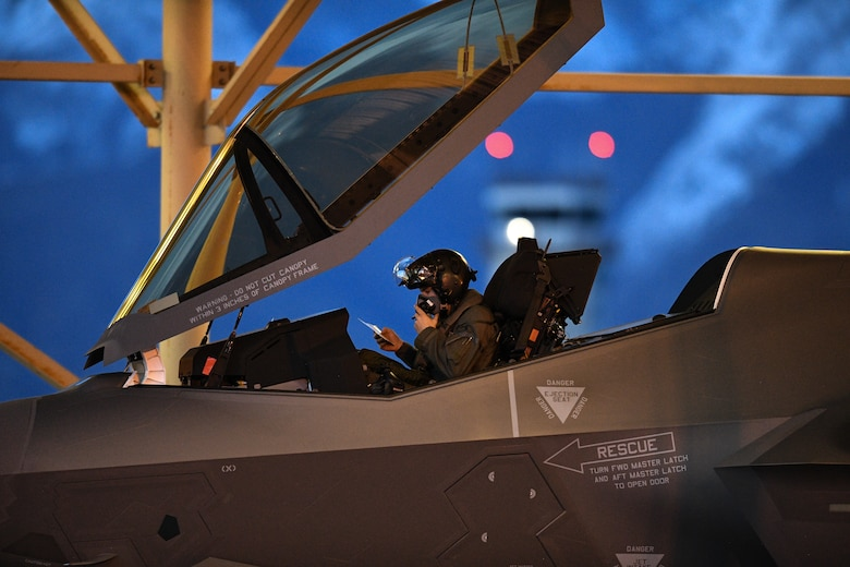 A pilot from the 388th Fighter Wing's 421st Fighter Squadron prepares to launch an F-35A Lightning II during night flying operations at Hill Air Force Base, Utah, March 26, 2019. Night flying is required for pilots to sharpen their combat skills. The 388th Fighter Wing is the Air Force's first combat-coded F-35A wing. (U.S. Air Force photo by R. Nial Bradshaw)