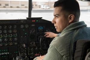 Airman inspecting aircraft.