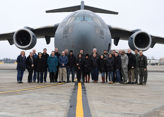 Alumni of Leadership Pittsburgh Inc. programs and members of the 911th Airlift Wing pose for a photo in front of a C-17 Globemaster III at the Pittsburgh International Airport Air Reserve Station, Pennsylvania, March 22, 2019. They were the first civic leaders to fly on the 911th AW's new C-17 aircraft after their base conversion from the C-130 Hercules aircraft. (U.S. Air Force photo by Senior Airman Grace Thomson)