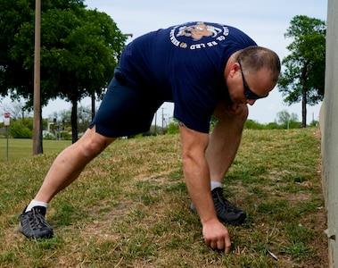 Chief Petty Officer Steven Kellystahlnecker, assigned to Navy Medicine Education, Training and Logistics Command at Joint Base San Antonio-Fort Sam Houston, picks up trash during a community relations event held at Martinez Park during a Sailor 360 event. Sailor 360 is a command-level program for junior enlisted, senior enlisted and junior officers designed to strengthen and develop leadership through COMREL events, classroom discussions and physical training events.