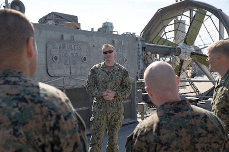JOINT EXPEDITIONARY BASE LITTLE CREEK, VIRGINIA BEACH, Va. – U.S. Navy Chief Eric Waters, a quarter master with Detachment 1, Assault Craft Unit FOUR, speaks to Marines and Sailors with U.S. Marine Corps Forces Command during a tour of the Landing Craft, Air Cushion March 29, 2019, aboard Joint Expeditionary Base Little Creek in Virginia Beach, Virginia.