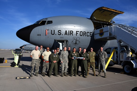 Col. Patrick Donaldson, commander, 161st Air Refueling Wing, Goldwater Air National Guard Base, Phoenix, accepts the key to KC-135 Stratotanker 57-1419 from Col. John Pogorek, commander, 157th Air Refueling Wing, Pease Air National Guard Base, N.H., March 24, 2019. (Photo by Master Sgt. Kelly Deitloff)