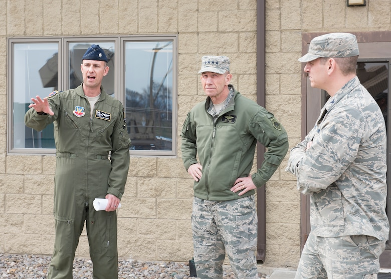 U.S. Air Force Lt. Col. Jay Labrum, 266th Range Squadron commander, talks to U.S. Air Force Gen. Mike Holmes, commander of Air Combat Command, about the jamming equipment that the squadron's Cowboy Control division uses, March 27, 2019, at Mountain Home Air Force Base, Idaho. Holmes visited MHAFB to view the innovative projects of squadrons on base. (U.S. Air Force photo by Senior Airman Tyrell Hall)