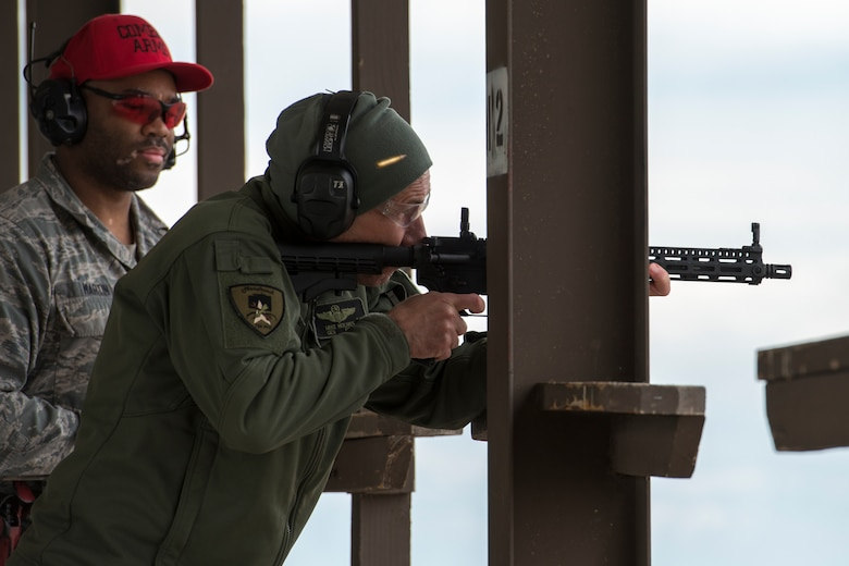 U.S. Air Force Gen. Mike Holmes, commander of Air Combat Command, fires a GAU-5 during a shoot, move, communicate course March 27, 2019, at the gun-range on Mountain Home Air Force Base, Idaho. The GAU-5 is a semi-automatic stand-off rifle that pilots carry with their ejection survival packs. (U.S. Air Force photo by Airman 1st Class JaNae Capuno)