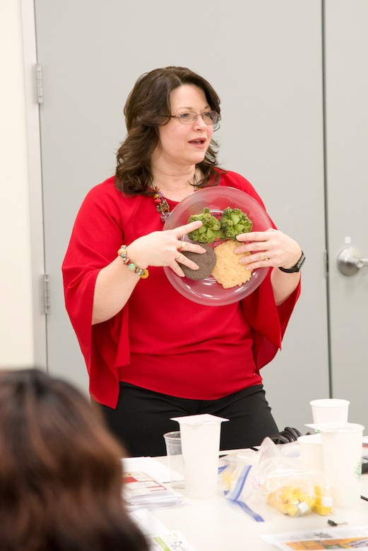 Mary Bouldin, a nurse educator from the Redstone Arsenal Center for Comprehensive Wellness, talks with Huntsville Center employees on the topic of nutrition in Huntsville, Alabama, March 29, 2019.