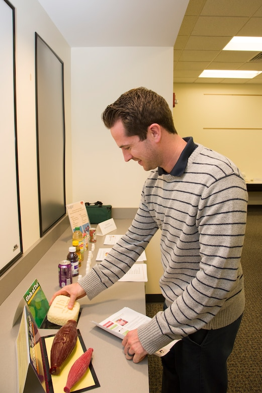 Kyle Shireman, safety manager with the Huntsville Center Safety Office, checks out the hands-on health exhibits from the Redstone Arsenal Center for Comprehensive Wellness before a lunchtime presentation from Mary Bouldin, a nurse educator, in Huntsville, Alabama, March 29, 2019.
