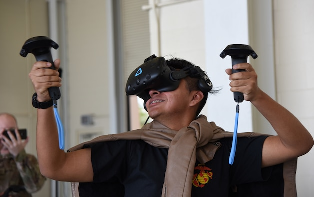Ausencio Bernal-Michua, Gulfport High School student, participates in a virtual reality demonstration provided by the 81st Training Support Squadron at the 5th Annual Science, Technology, Engineering and Mathematics Diversity Outreach Day on Keesler Air Force Base, Mississippi, March 29, 2019. The event consisted of eight Mississippi Gulf Coast high school Junior ROTC units viewing an 81st Security Forces Squadron military working dog demonstration and receiving information about Air Force opportunities and accession requirements with an emphasis on STEM. They also competed in several team building activities. (U.S. Air Force photo by Kemberly Groue)