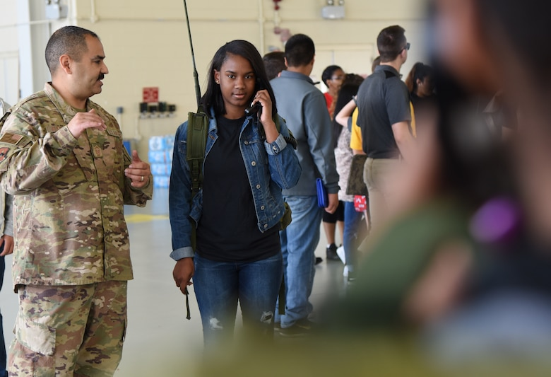 U.S. Air Force Master Sgt. Gilbert Barrera, 338th Training Squadron assistant flight chief, provides Morgan Samuels and Shajai Trautman, Gulfport High School students, with a radio frequency transmissions demonstration at the 5th Annual Science, Technology, Engineering and Mathematics Diversity Outreach Day on Keesler Air Force Base, Mississippi, March 29, 2019. The event consisted of eight Mississippi Gulf Coast high school Junior ROTC units viewing an 81st Security Forces Squadron military working dog demonstration and receiving information about Air Force opportunities and accession requirements with an emphasis on STEM. They also competed in several team building activities. (U.S. Air Force photo by Kemberly Groue)