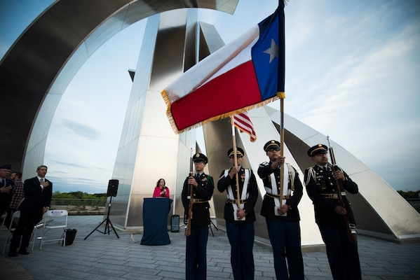 Students from John F. Kennedy High School ROTC participate during the Freedom sculpture grand opening, Mar. 27, 2019, at the corner of U.S. Highway 90 and Military Drive.