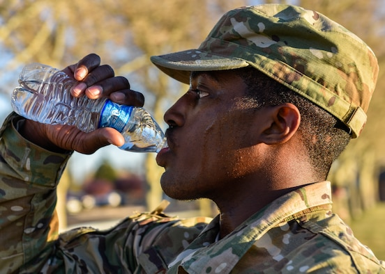 U.S. Air Force Airman 1st Class Yaukis Cole, 377th Weapons System Security Squadron, drinks water at Kirtland Air Force Base, N.M., March 29, 2019. Cole finished the three mile ruck second with a time of approximately 24 minutes. (U.S. Air Force photo by Airman 1st Class Austin J. Prisbrey)